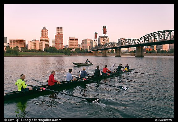 Eight-oar shell and city skyline at sunrise. Portland, Oregon, USA