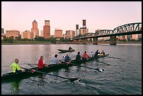 Eight-oar shell and city skyline at sunrise. Portland, Oregon, USA (color)
