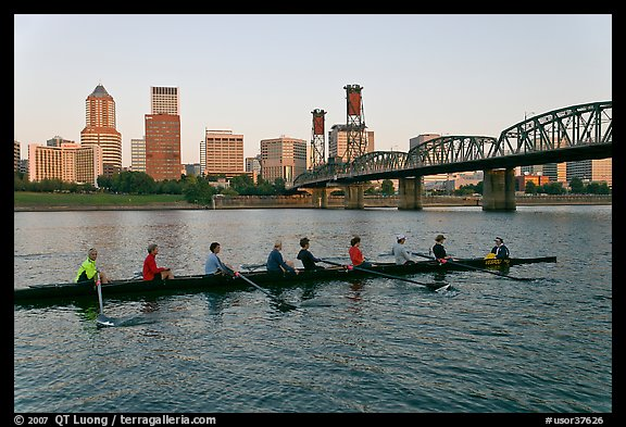 Eight-oar shell on Williamette River and city skyline. Portland, Oregon, USA (color)