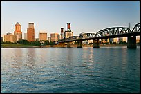 Portland skyline, Hawthorne Bridge, and Williamette River at sunrise. Portland, Oregon, USA