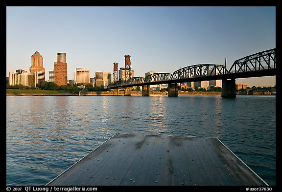 Deck, and Portland skyline with bridge at sunrise. Portland, Oregon, USA