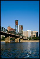 Williamette River at Hawthorne Bridge and high-rise buildings. Portland, Oregon, USA