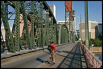 Bicyclist on Hawthorne Bridge. Portland, Oregon, USA