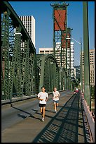 Men jogging on Hawthorne Bridge. Portland, Oregon, USA
