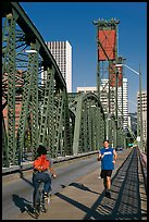 Jogger and cyclist on Hawthorne Bridge. Portland, Oregon, USA (color)