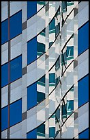 Pattern of windows and reflections in high rise building. Portland, Oregon, USA