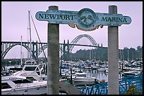 Newport marina and sign, foggy sunrise. Newport, Oregon, USA