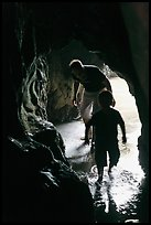Boy and man exploring sea cave. Bandon, Oregon, USA