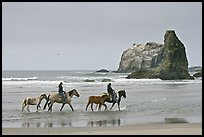 Women ridding horses on beach. Bandon, Oregon, USA (color)