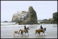 Women horse-riding on beach. Bandon, Oregon, USA (color)