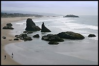 Beach at Face Rock with two people walking. Bandon, Oregon, USA ( color)