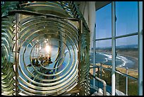 Light inside Cape Blanco Lighthouse tower and landscape. Oregon, USA (color)