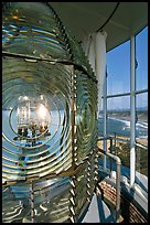 Rotating light inside Cape Blanco Lighthouse tower and landscape. Oregon, USA ( color)