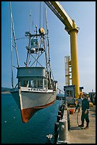Fishing boat hoisted from water, Port Orford. Oregon, USA ( color)