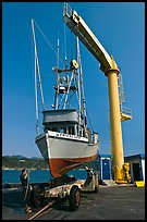 Fishing boat lifted from water by huge hoist, Port Orford. Oregon, USA (color)
