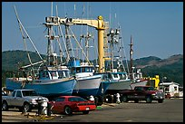 Fishing boats and cars parked on deck, Port Orford. Oregon, USA (color)
