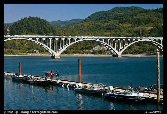 Small boat deck and Rogue River bridge. Oregon, USA (color)