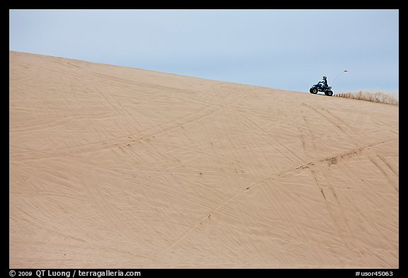 All terrain vehicle on dune crest, Oregon Dunes National Recreation Area. Oregon, USA