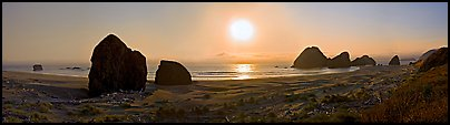 Pacific coastal scenery with setting sun, Pistol River State Park. Oregon, USA (Panoramic color)