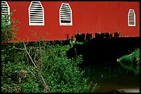 Detail of red covered bridge and river, Willamette Valley. Oregon, USA
