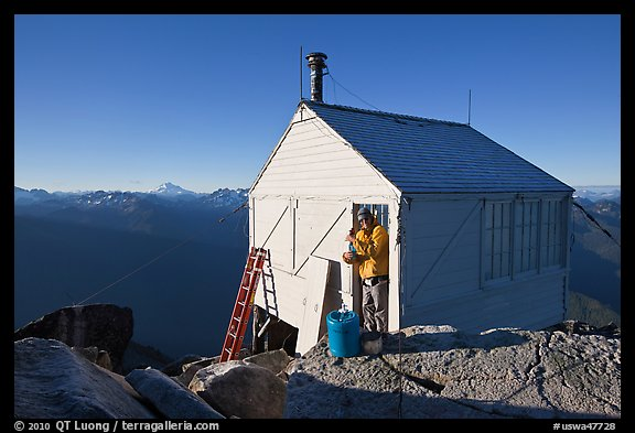 Man standing in doorway of Hidden Lake lookout. Washington