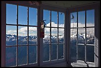 Mountains seen through windows of Hidden Lake Lookout. Washington