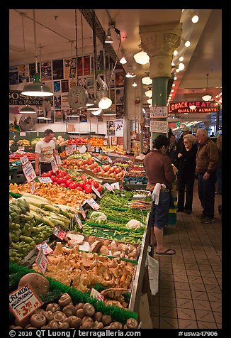 Fruit and vegetable market in Main Arcade, Pike Place Market. Seattle, Washington (color)