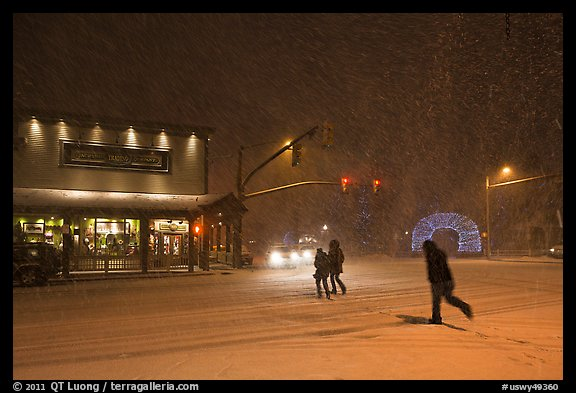 People cross street in night blizzard. Jackson, Wyoming, USA (color)