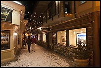 Alley with art galleries, winter night. Jackson, Wyoming, USA (color)