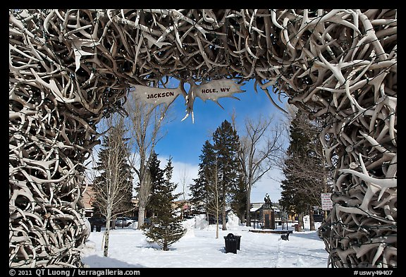 Town Square framed by Antler Arch in winter. Jackson, Wyoming, USA (color)