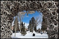 Town Square framed by Antler Arch in winter. Jackson, Wyoming, USA ( color)