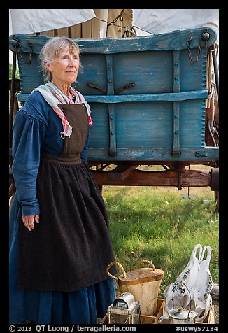 Woman with Pionneer wagon. Fort Laramie National Historical Site, Wyoming, USA (color)