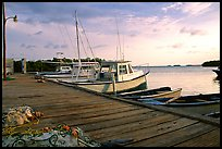 Pier and small boats at sunset, La Parguera. Puerto Rico (color)