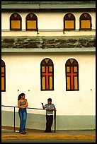 Woman and boy talking besides a church, La Parguera. Puerto Rico ( color)
