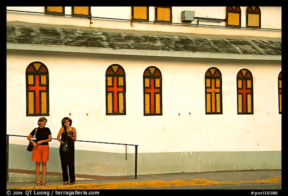 Two women standing in front of a church, La Parguera. Puerto Rico (color)