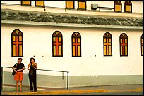Two women standing in front of a church, La Parguera. Puerto Rico ( color)