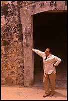 Man standing next to a doorway, El Morro Fortress. San Juan, Puerto Rico (color)