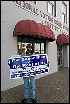 African-American man holding a voting sign in front of the voting rights museum. Selma, Alabama, USA ( color)