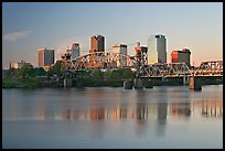 Skyline and bridge with reflections in river at sunrise. Little Rock, Arkansas, USA