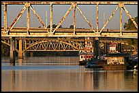 Bridges over Arkansas River, submarine and riverboats at sunrise. Little Rock, Arkansas, USA (color)