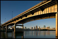 Skyline framed by bridge at sunrise. Little Rock, Arkansas, USA (color)