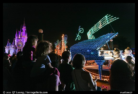Families watching night parade, Magic Kingdom. Orlando, Florida, USA (color)