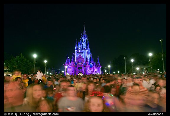 Crowds on Main Street with castle in the back at night. Orlando, Florida, USA (color)