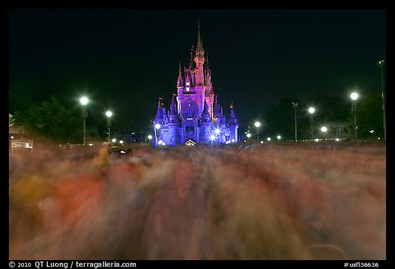 Blurry crowds and Cinderella Castle, Walt Disney World. Orlando, Florida, USA (color)