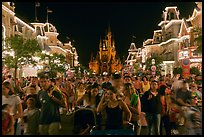 Main Street at night with crowds and castle. Orlando, Florida, USA