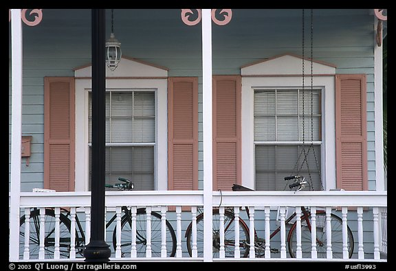 Bicycle on pastel-colored porch. Key West, Florida, USA (color)