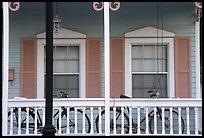 Bicycle on pastel-colored porch. Key West, Florida, USA