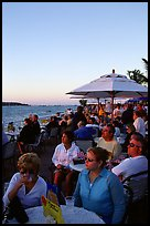 Crowds celebrating sunset at Mallory Square. Key West, Florida, USA (color)