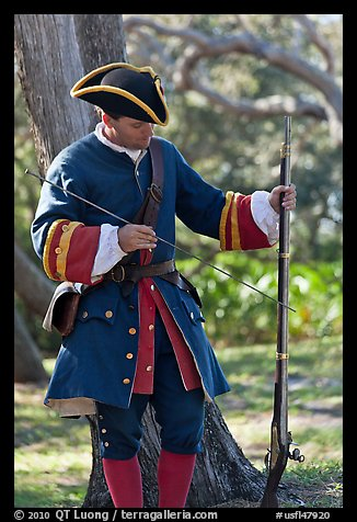 Man useing ramrod on musket, Fort Matanzas National Monument. St Augustine, Florida, USA