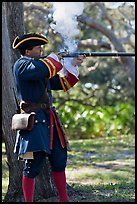 Man in period costume fires smooth bore musket, Fort Matanzas National Monument. St Augustine, Florida, USA (color)